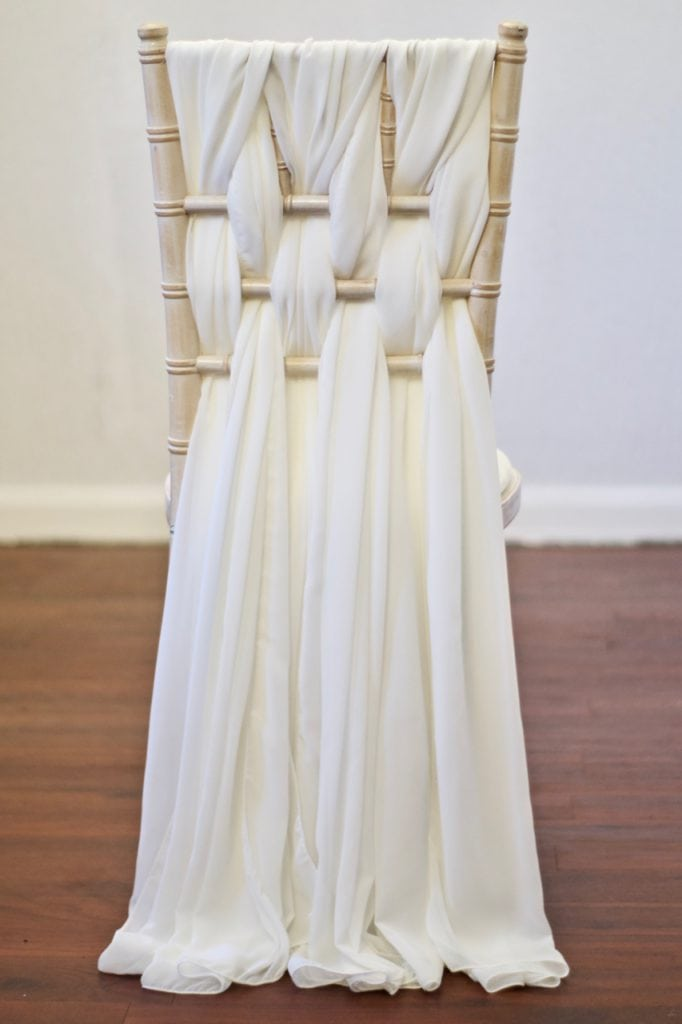 Ivory Chiffon Weave Chair Decoration on a Chiavari Chair