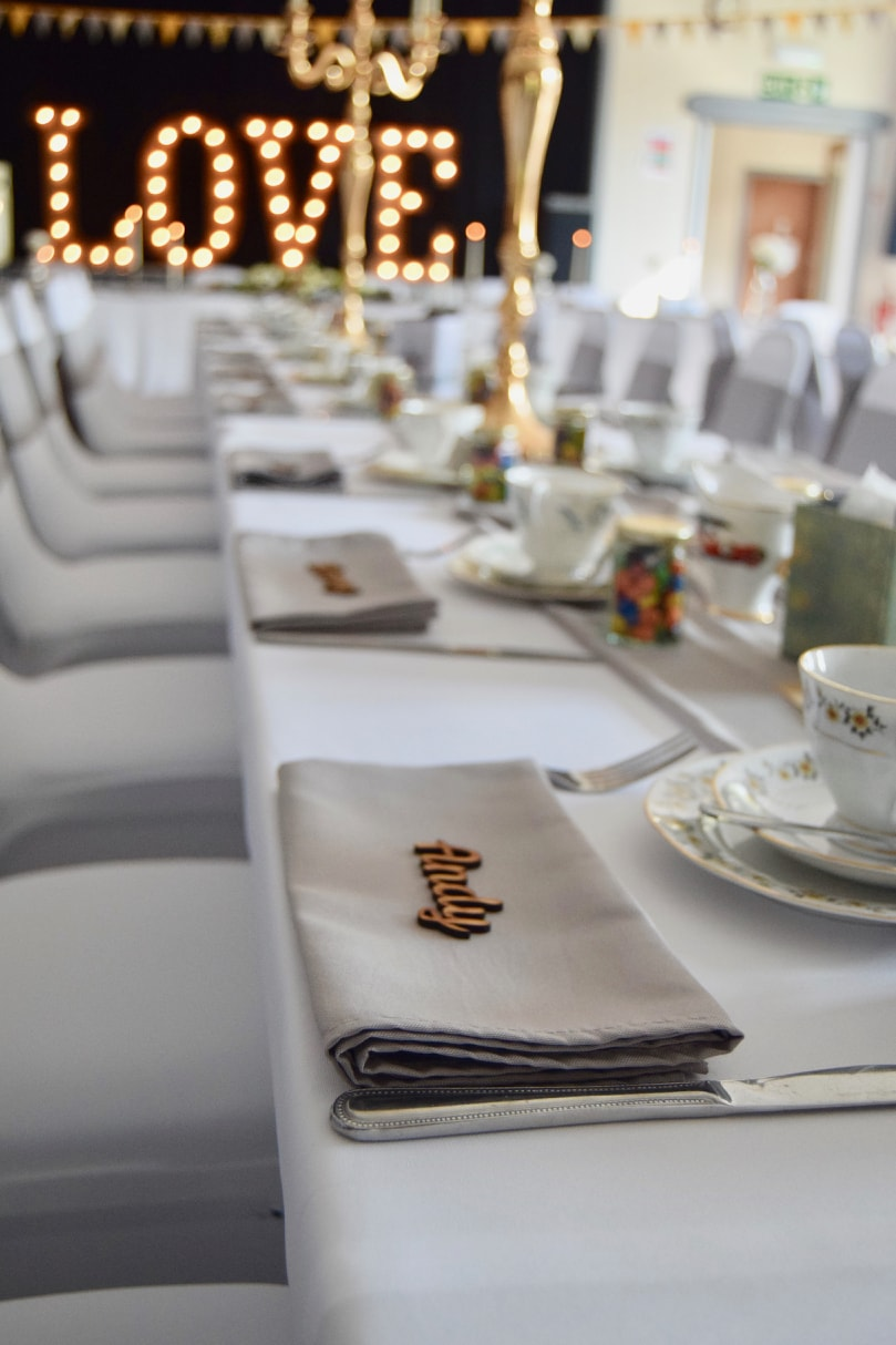 Grey Napkins, Laser Cut Wooden Place Names, Gold Candelabras and LOVE Letters