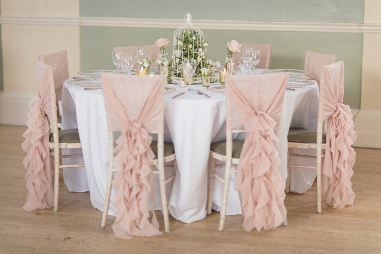 Nude Pink Ruffle Hoods on Chiavari Chairs