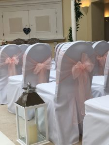 White Polyester Chair Covers with Blush Pink Organza Sashes