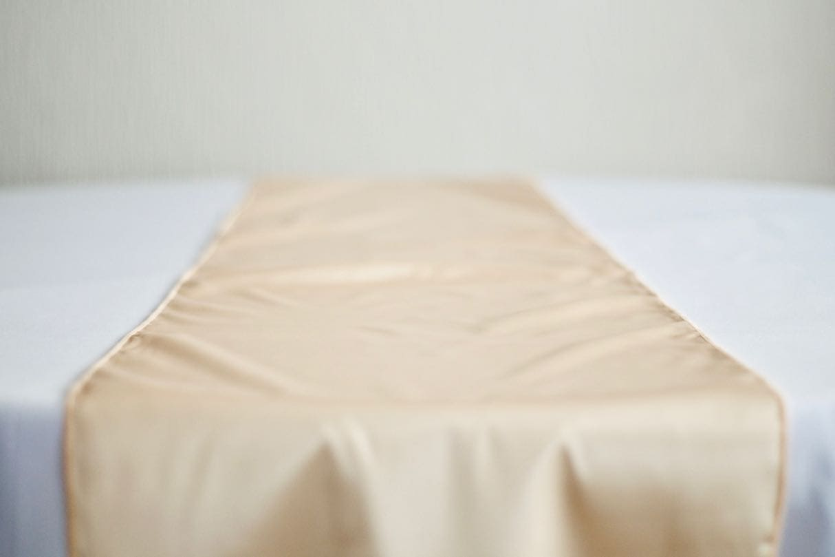 Champagne Satin Table Runner on White Table Cloth