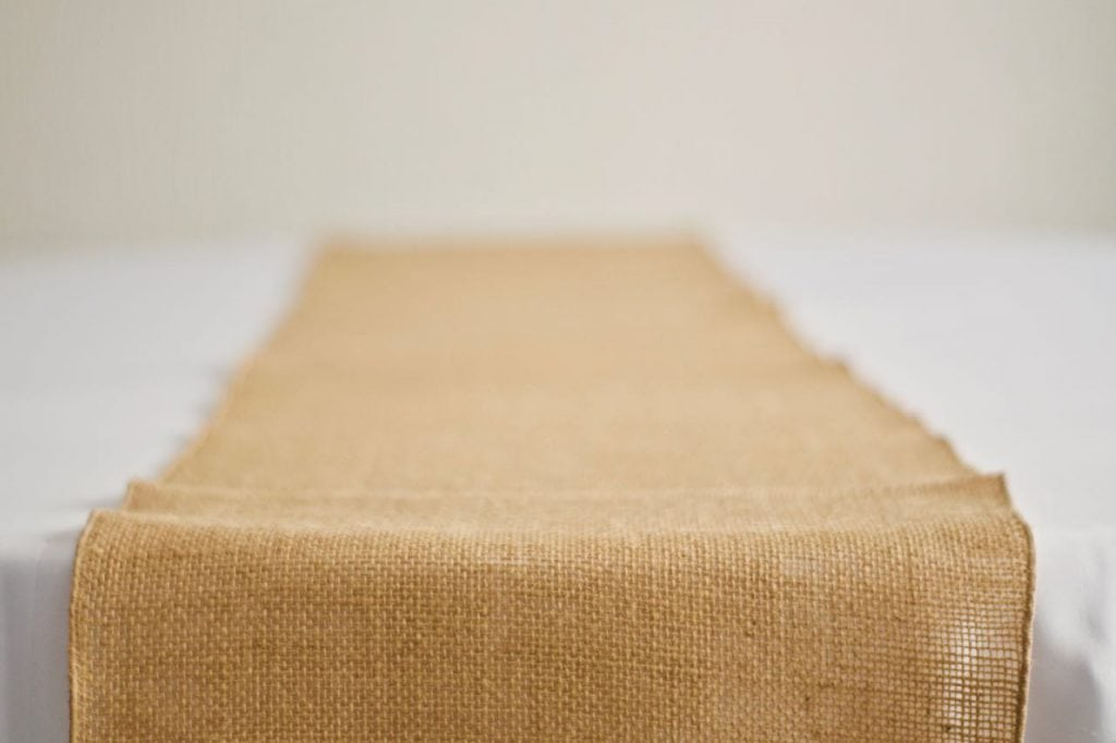 Hessian Table Runner on White Table Cloth