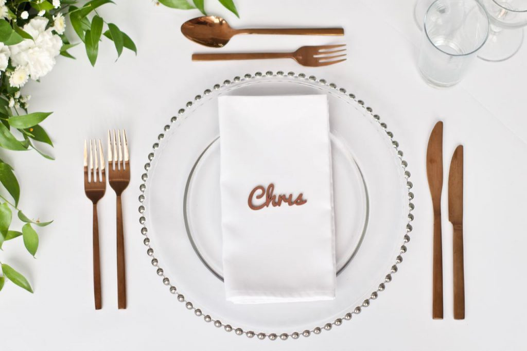 Silver Beaded Charger Plate with White Napkin, Rose Gold Laser Cut Wooden Place Name and Rose Gold Cutlery